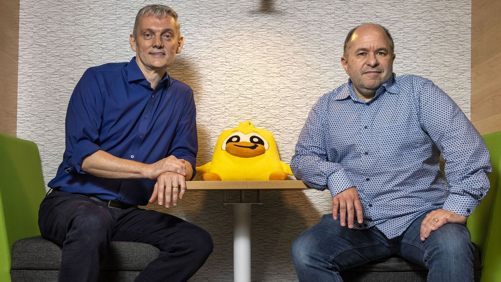 Chief Operating Officer John Boog-Scott, left, and CEO Tony Goodman pose for a portrait at the PeopleFun office in Richardson. PeopleFun is one of the world's top developers of casual mobile games.