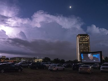 A storm brews south east of Rooftop Cinema Club drive-in off Central Expressway in Dallas, Wednesday, Aug. 26, 2020. Catching a drive-in movie is one of our socially distanced date ideas.