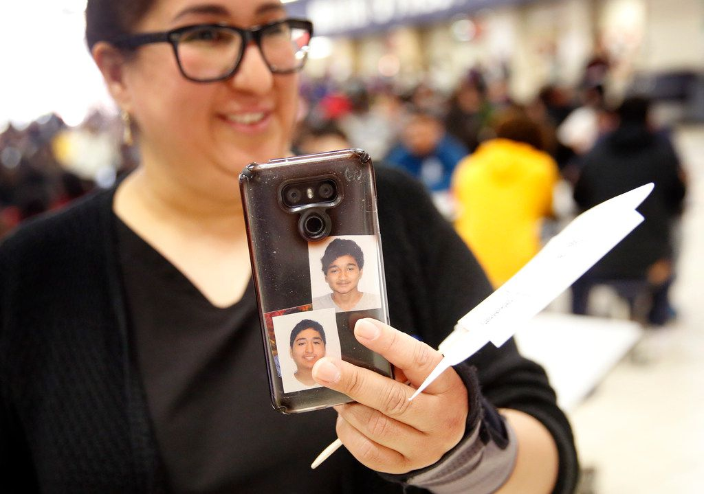 Duncanville High School freshman David Mojica's mother Ericka Martinez uses her smartphone to do a Facebook Live of her son's bone marrow donor drive during lunchtime in the high school cafeteria in Duncanville, Texas, Thursday, March 21, 2019. The  marrow drive was for Mojica (pictured on her phone, right, with his brother, Erick Mojica) who suffers from aplastic anemia, a rare and life-threatening blood disorder. But it also is for those who are also in need of a bone-marrow transplant. The May 2018 diagnosis quickly put David in desperate need of a transplant.