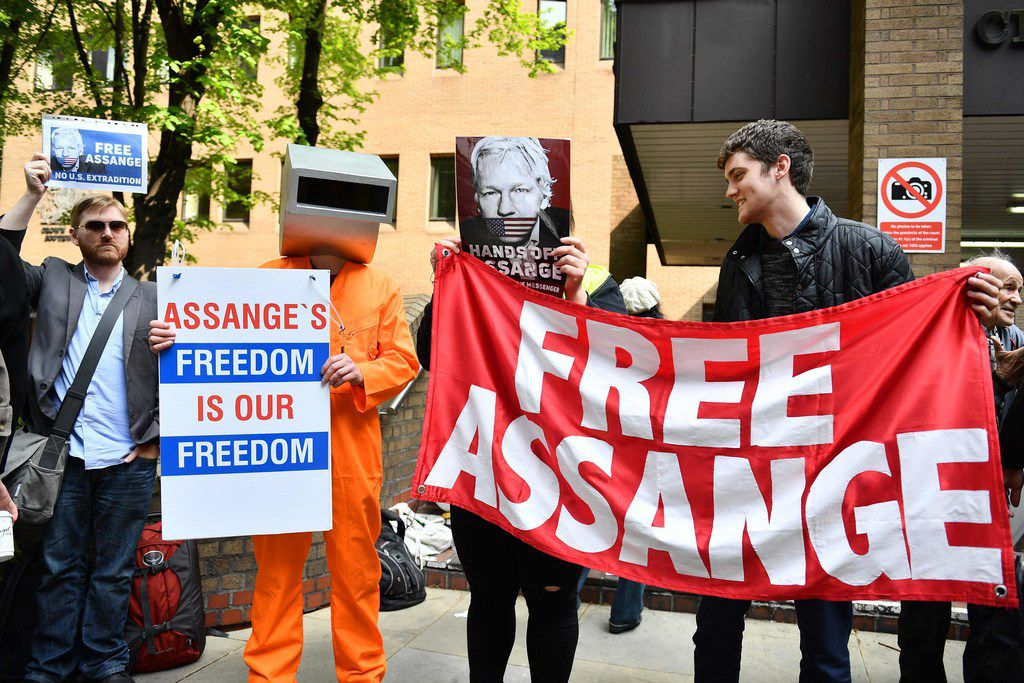 Supporters of WikiLeaks founder Julian Assange protest May 1, 2019, outside court in London, where Assange was sentenced for bail violation.
