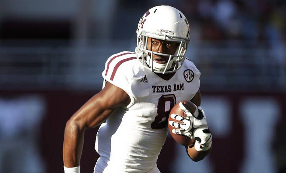 Former Dallas Skyline star Thomas Johnson runs after making one of his three receptions in Texas A&M's stunning upset of then-No. 1 Alabama on Nov. 10, 2012. Johnson, who disappeared shortly after the game and never played college football again, was arrested Monday in the brutal slaying of a jogger on the White Rock Creek Trail in Dallas. (File photo/Associated Press)