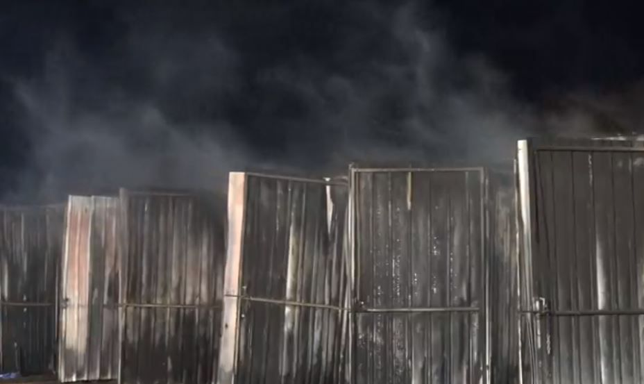 Storage units smolder after a fire struck a boat repair shop Tuesday morning in Grapevine.