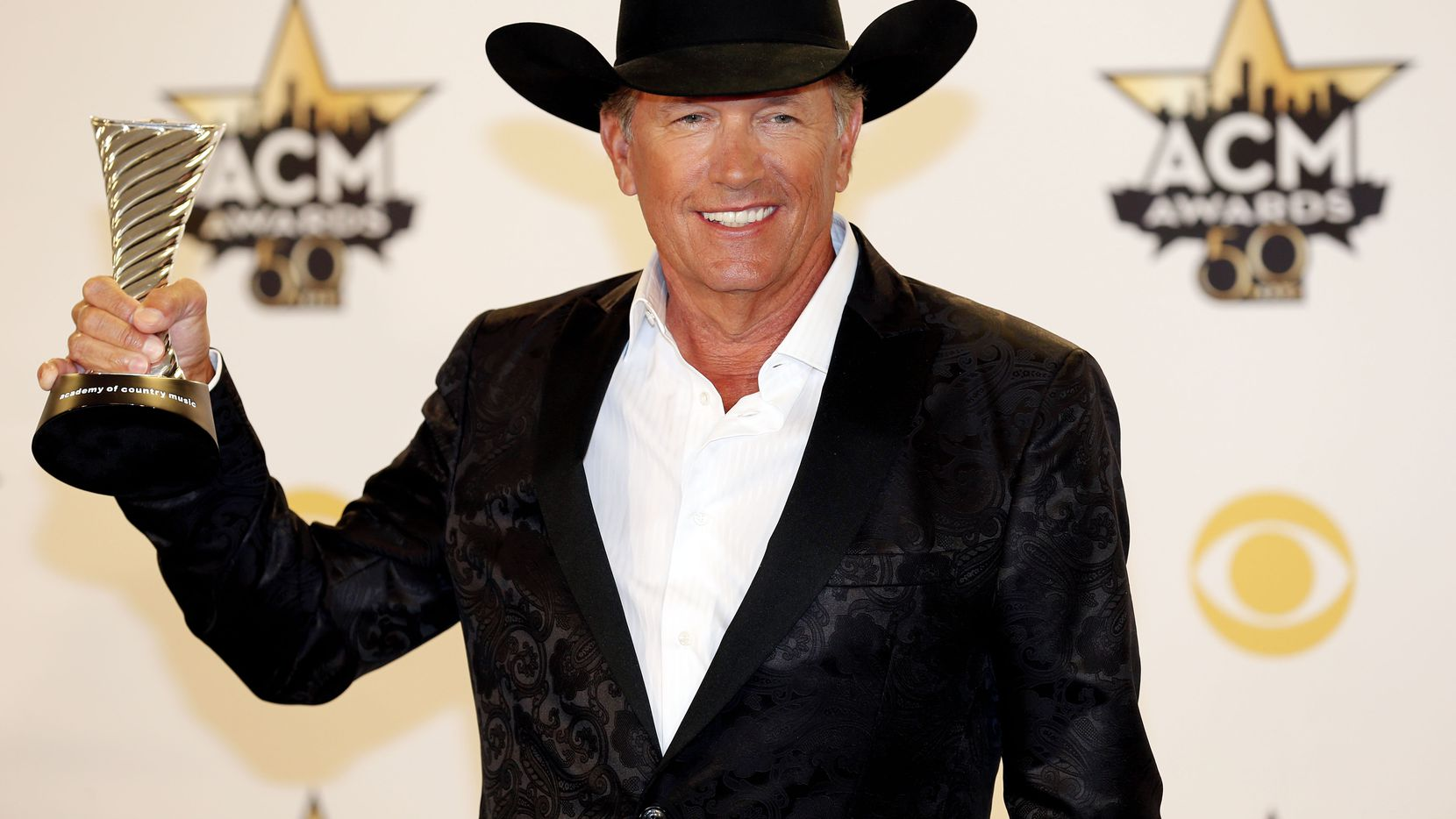 George Strait poses for a photo with his Milestone Award during the 2015 Academy of Country Music Awards Sunday, April 19, 2015 at AT&T Stadium in Arlington, Texas.