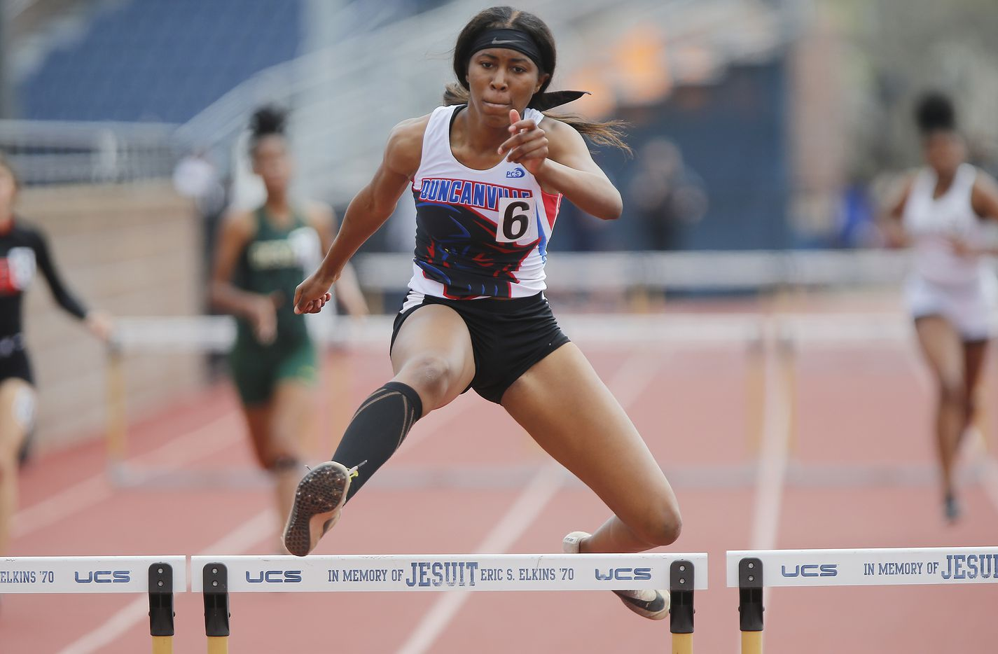Loreal Jones, 16, of Duncanville High School, finished first in the second heat of the girls 300 meter hurdles during the Jesuit-Sheaner Relays held at Jesuit College Preparatory School in Dallas on Saturday, March 27, 2021.  (Stewart F. House/Special Contributor)