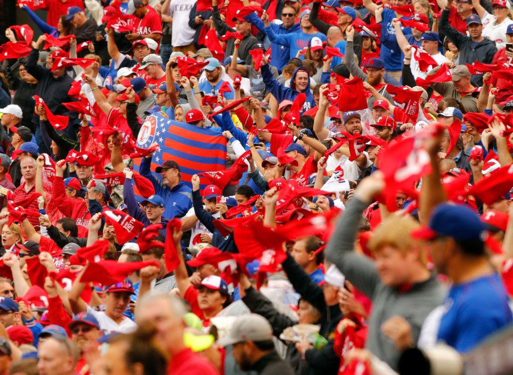 Rangers fans waved their red towels as the Rangers and Toronto Blue Jays took the field for Game 2 of the ALDS at Globe Life Park in Arlington on Oct. 7. (Tom Fox/Staff Photographer)