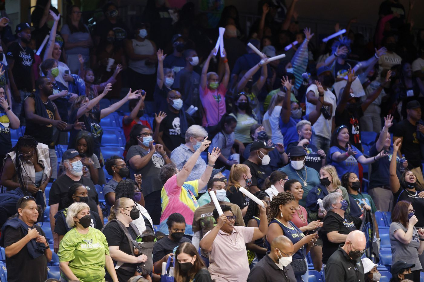 Fans celebrate as the Dallas Wings defeated the Los Angeles Sparks 87-84 during the second half of a WNBA basketball game in Arlington, Texas on Sunday, Sept. 19, 2021. (Michael Ainsworth/Special Contributor)