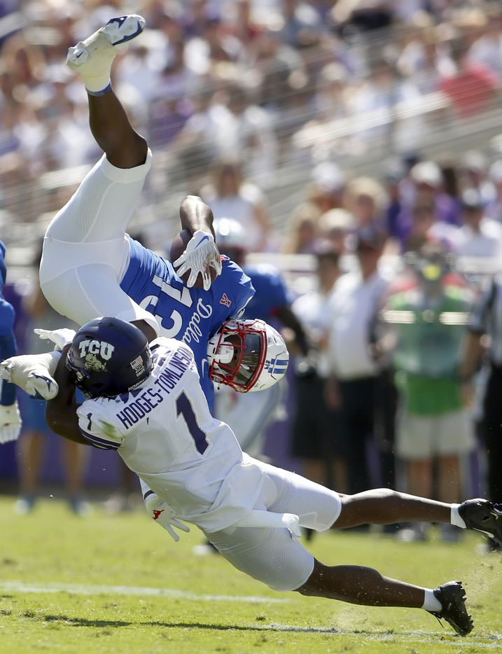 SMU receiver Roderick Daniels, Jr. (13) is upended by TCU cornerback Tri'Vius Hodges-Tomlinson (1) after a short gain following a 2nd quarter reception. The two teams played their NCAA football game at Amon G. Carter Stadium on the campus of TCU in Fort Worth on September 25, 2021. (Steve Hamm/ Special Contributor)