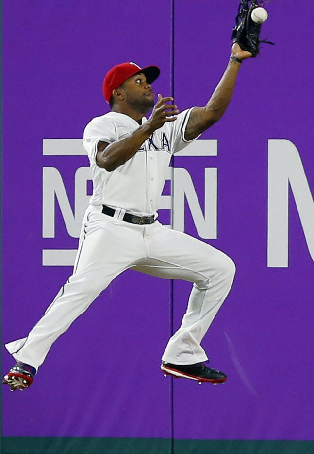 Texas Rangers center fielder Delino DeShields (3) attempts a flying catch of a deep ball hit by Houston Astros batter Tyler White in the sixth inning at the Globe Life Park in Arlington, Tuesday, April 19, 2016. White hit a double on the play. (Tom Fox/The Dallas Morning News)
