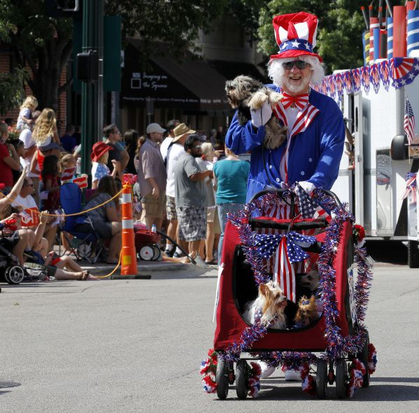 Danny Cox took part in the 4th of July parade with some of his dogs in downtown McKinney last year. This year, the parade will be 'reversed,' with participants stationary and attendees driving through to maintain social distancing.