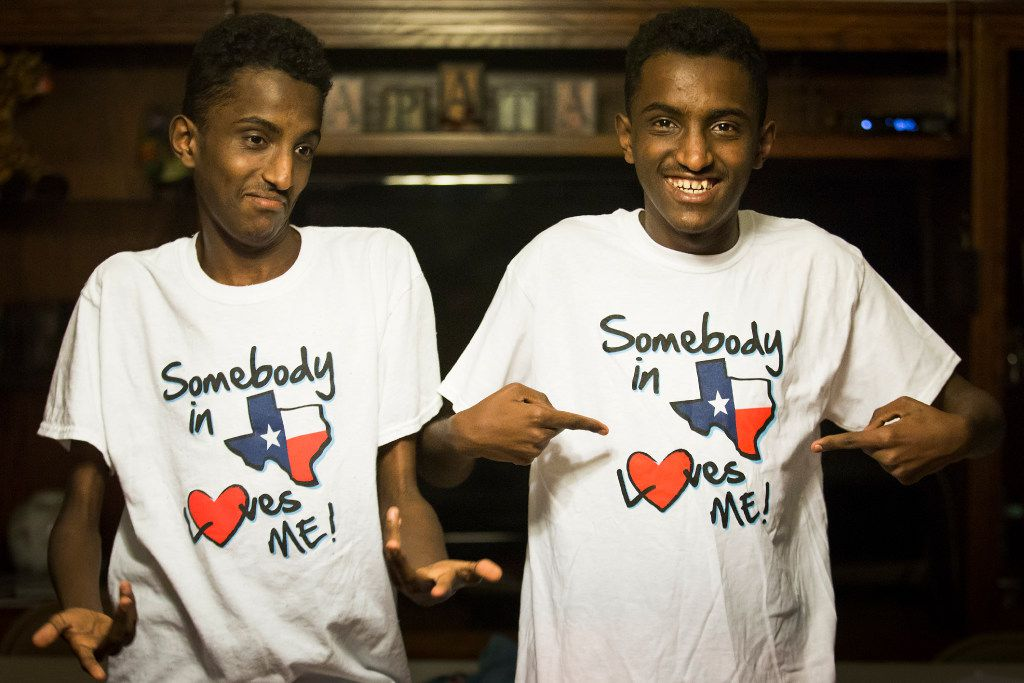 """Ethiopian twins, Marcos (right) and Tamirat Bogale show off their T-shirts reading """"Somebody in Texas Loves Me!"""" during a going away party at the home of their host Cheryl Zapata and her family on Monday, April 24, 2017, in Plano."""