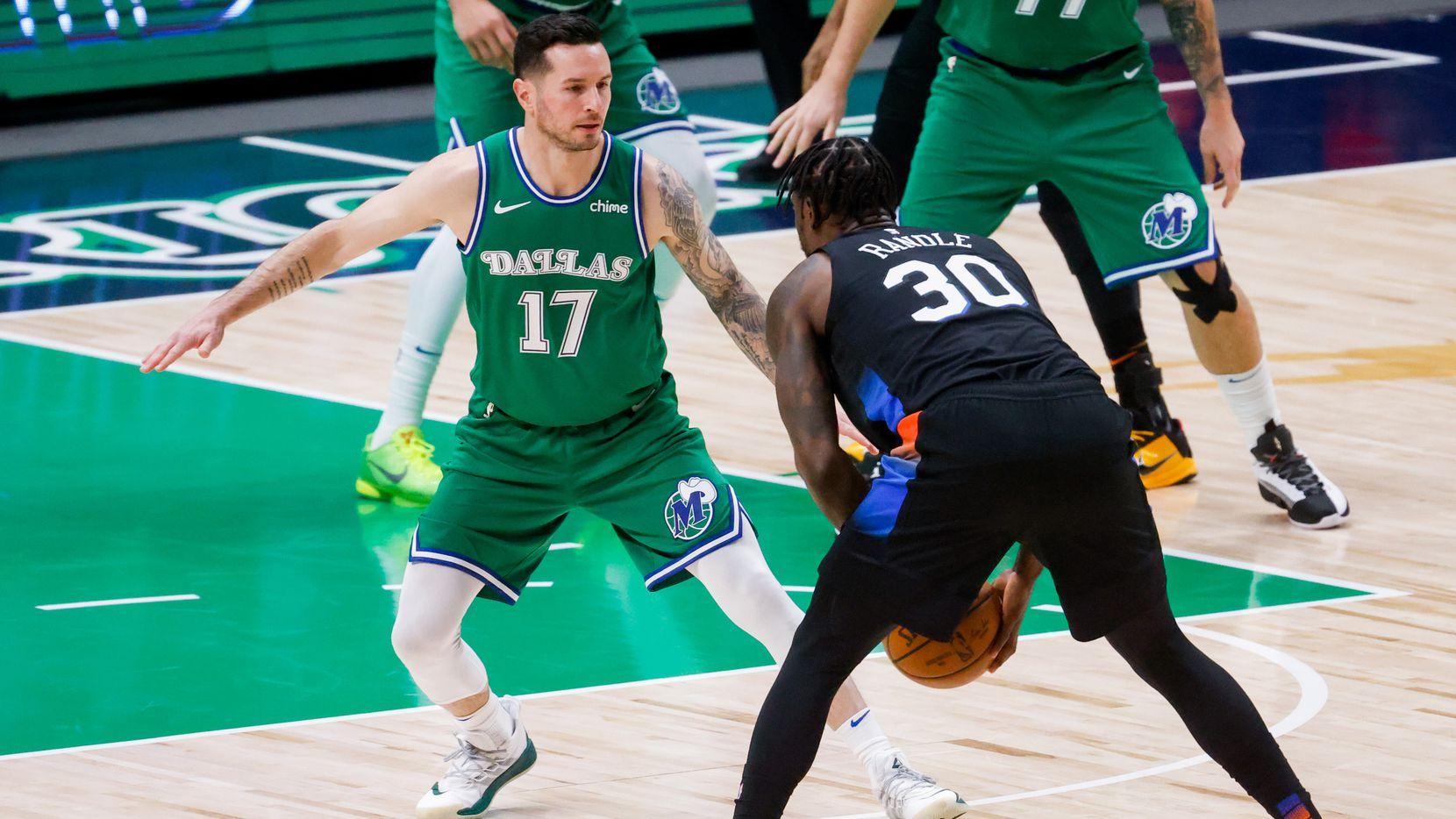 Dallas Mavericks guard JJ Redick (17) blocks New York Knicks forward Julius Randle (30) in the first half at American Airlines Center in Dallas on Friday, April 16, 2021.