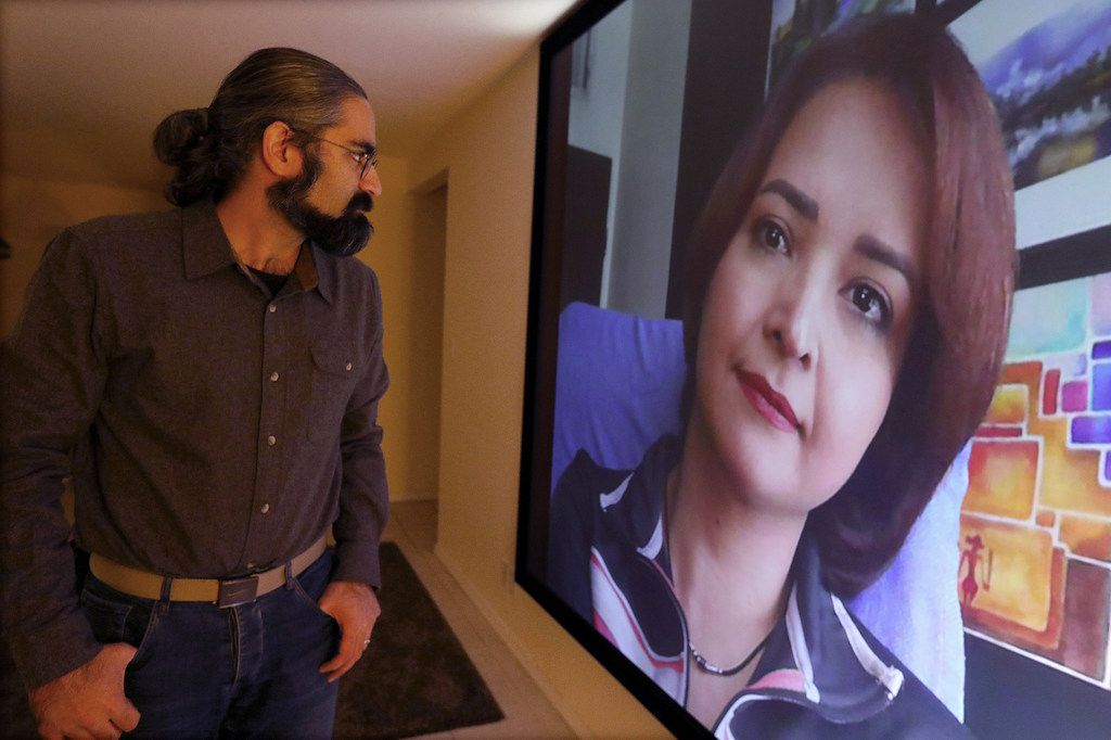 Rad Cyrus, an Iranian immigrant and tech worker living in Shoreline, Wash., looks forward to evenings at home, when he spends time with his wife through video chat. She lives in Tehran and has been waiting years for a visa.