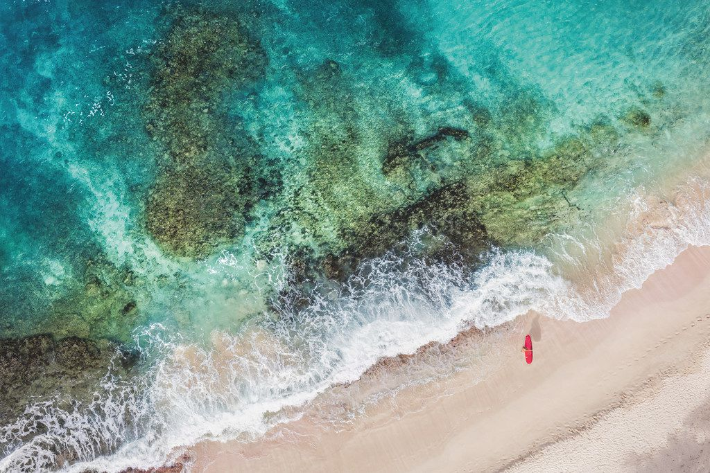 Gray Malin's second book, Escape, covers tropical locations in photos including St. Barths Red Surfboard as well as cityscapes and more.