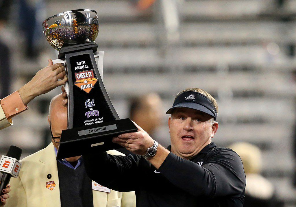 TCU coach Gary Patterson holds up the trophy after the team's Cheez-It Bowl NCAA college football game against California on Wednesday, Dec. 26, 2018, in Phoenix. TCU defeated California 10-7 in overtime. (AP Photo/Ross D. Franklin)
