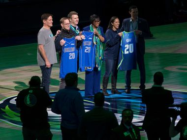 Dallas Mavericks owner Mark Cuban poses for a photo with representatives from Chime during the first quarter of an NBA game between the Dallas Mavericks and the Portland Trail Blazers on Friday, January 17, 2020 at American Airlines Center in Dallas. Mavs jerseys will wear a Chime patch on their jerseys this season.