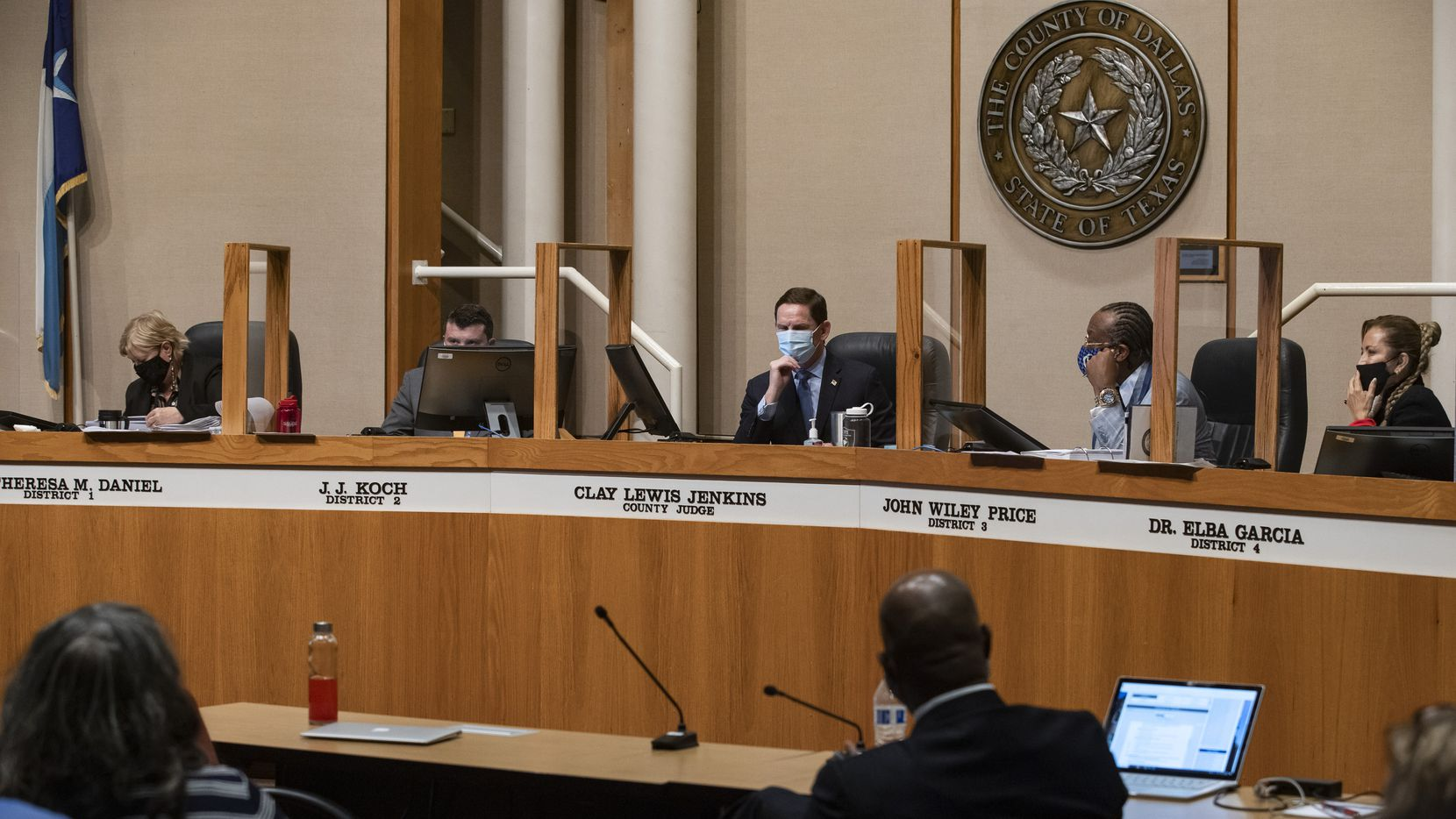 Dallas County Judge Clay Jenkins (center) and county commissioners listened to a presentation during a meeting at the County Administration Building in Dallas on May 18, 2021.