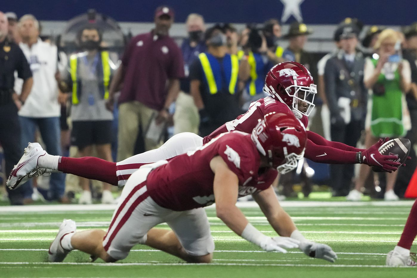 Arkansas defensive back Montaric Brown (21) makes a diving interception during the second half of an NCAA football game against Texas A&M at AT&T Stadium on Saturday, Sept. 25, 2021, in Arlington. Arkansas won the game 20-10.