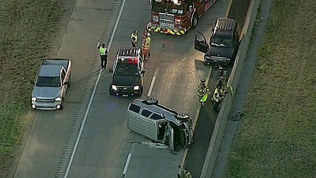 An overturned vehicle shut down State Highway 121 Monday morning.