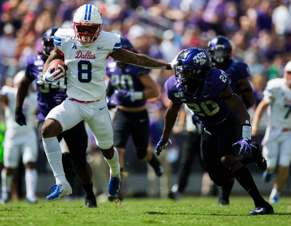 FILE - SMU wide receiver Reggie Roberson Jr. (8) stiff-arms TCU safety La'Kendrick Van Zandt (20) during the first quarter of a game on Saturday, Sept. 21, 2019, at Amon G. Carter Stadium in Fort Worth.