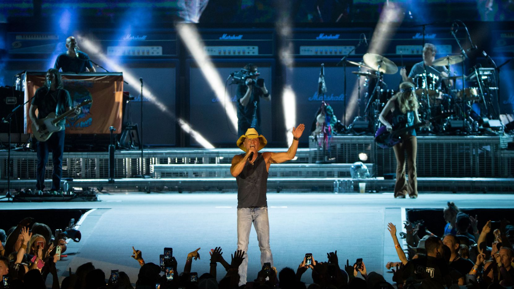 Kenny Chesney performs on stage during the his Spread the Love Tour concert at AT&T Stadium on June 4, 2016 in Arlington.