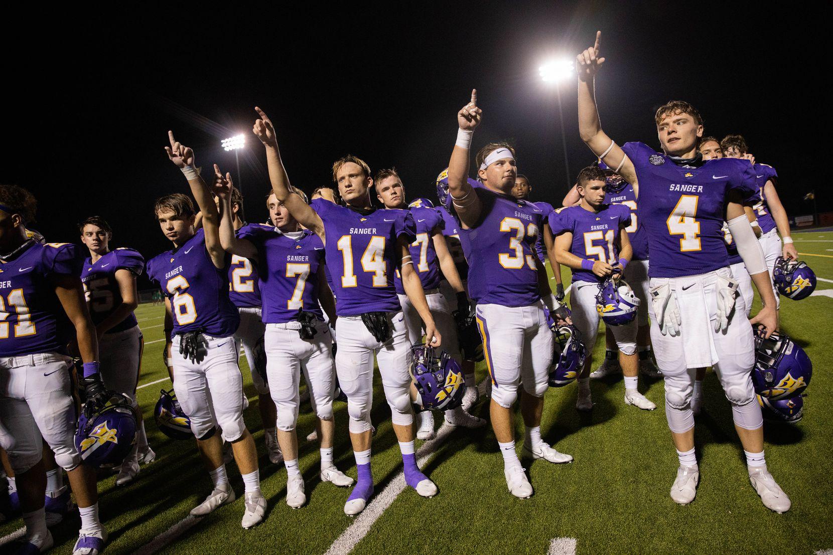Sanger High School players celebrate after winning against Lake Worth High School on Sept. 4, 2020 in Sanger. Sanger won 49-35. (Juan Figueroa/ The Dallas Morning News)