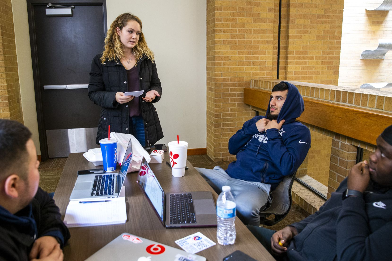 Arianna Bencid (center), senior, surveys sophomores Carlos Aguilar (second from right) and Jack Agbadiba (right) about the 2020 census in the University Center at the University of Texas at Arlington campus in Arlington, Texas, on Thursday, Feb. 13, 2020. Bencid and other members of the Public Relations Student Society of America chapter at UTA are leading a campaign to encourage student participation in the 2020 census.(Lynda M. Gonzalez/The Dallas Morning News)