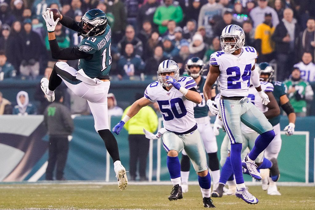 FILE - Eagles wide receiver J.J. Arcega-Whiteside (19) catches a pass as Cowboys cornerback Chidobe Awuzie (24) defends during the first half of a game at Lincoln Financial Field on Sunday, Dec. 22, 2019, in Philadelphia.