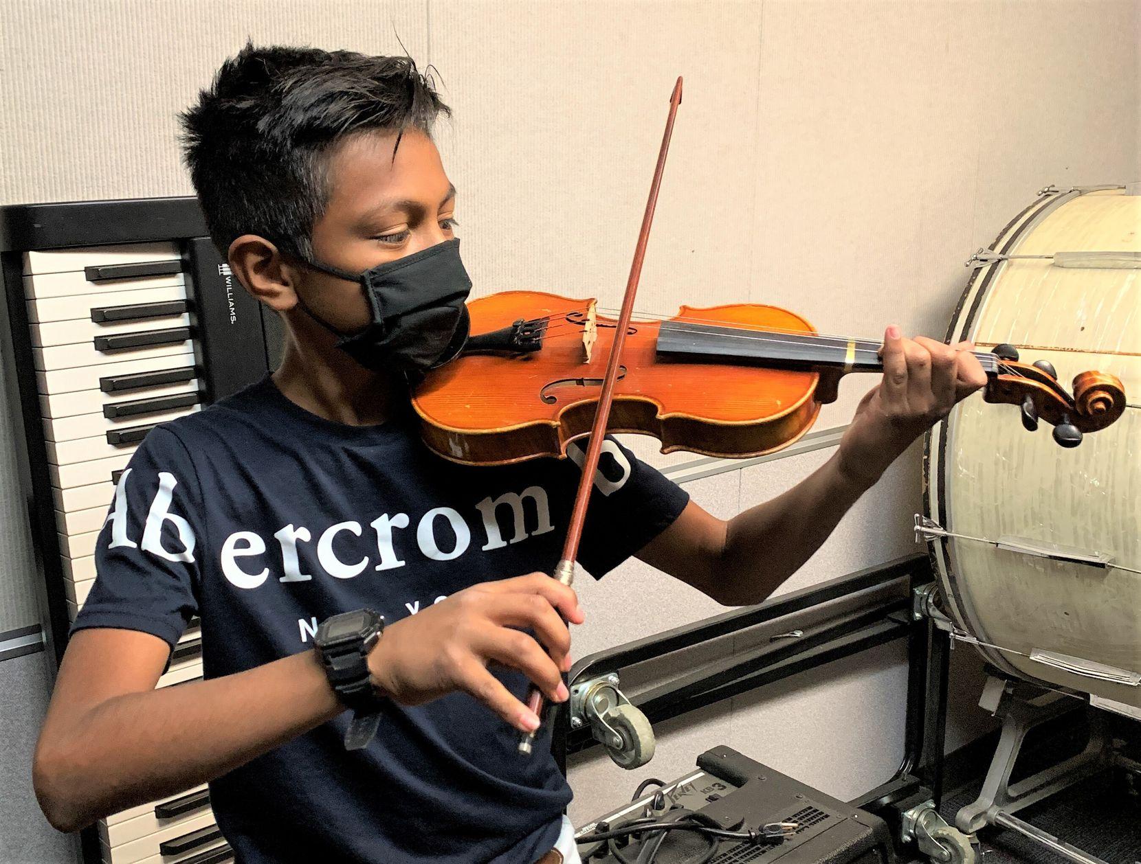 Seventh-grader Damian Resendiz of Greenville Middle School plays violin.
