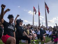 From left, co-organizers Aliyah Russell, Tierra Jenae Giles and other protesters raise their fists while participating in an 8-minute and 46-second kneel in honor of George Floyd during a demonstration at Dallas City Hall to denounce police brutality and systemic racism in Dallas on Thursday, June 4, 2020. The demonstration took place on the seventh consecutive day of organized protests in response to the recent deaths of George Floyd in Minneapolis and Breonna Taylor in Louisville.