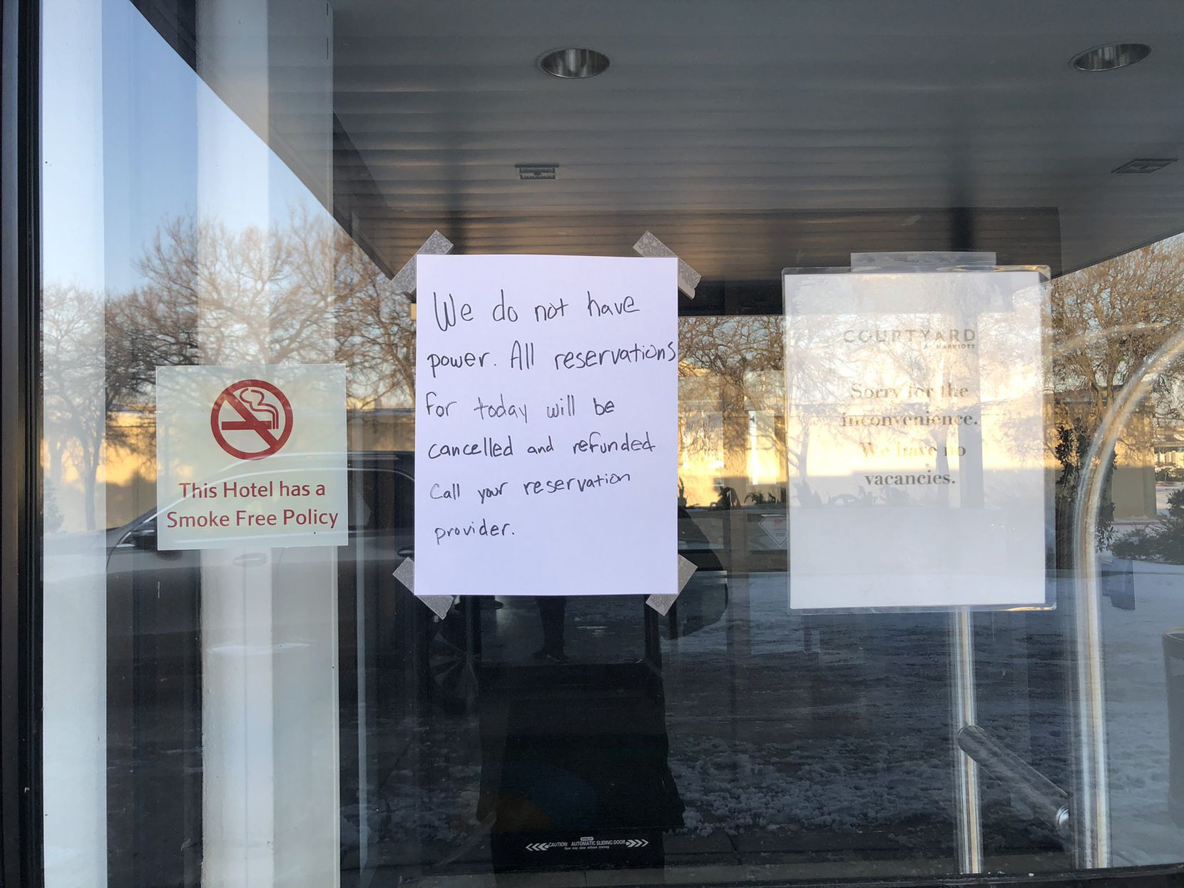 A note posted on the front door of the Courtyard Marriott in Addison on Feb. 15, 2021.
