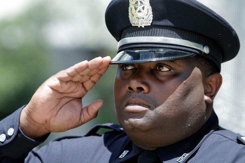 Senior Cpl. D. F. Black salutes during Taps at the annual Dallas Police Memorial Service on Wednesday.