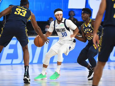 Orlando, FL - JULY 26: Seth Curry #30 of the Dallas Mavericks handles the ball against the Indiana Pacers during a scrimmage on July 26, 2020 at HP Field House at ESPN Wide World of Sports in Orlando, Florida.