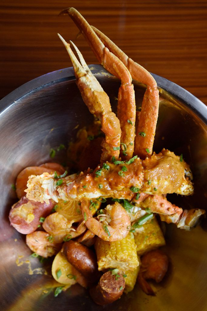 Alaskan king crab smothered in Cajun garlic butter comes with potatoes, sausage and corn.