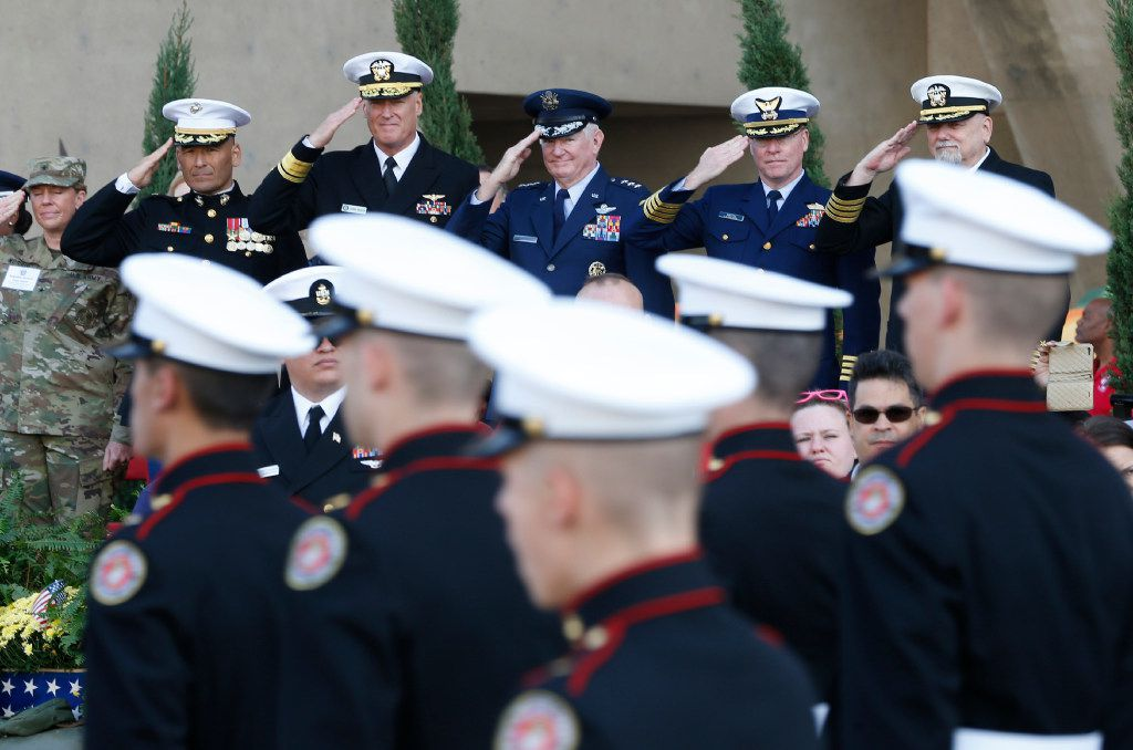Top military brass saluted soldiers during the Dallas Veterans Day Parade in 2016. (Nathan Hunsinger/Staff Photographer)