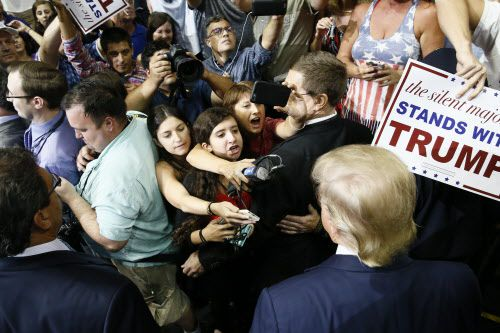 Republican presidential candidate Donald Trump mingles with reporters and onlookers after his speech at American Airlines Center in Dallas, Monday September 14, 2015. The young lady in the center, with her mouth open to ask a question, is Greenhill School newspaper editor Catherine Leffert. (Nathan Hunsinger/The Dallas Morning News)