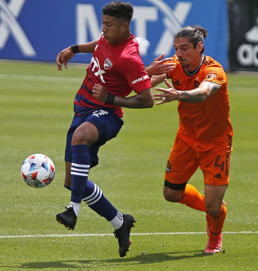 FC Dallas midfielder Freddy Vargas (17) makes a pass in front of Houston Dynamo defender Zarek Valentin (4) during the first half as FC Dallas hosted the Houston Dynamo at Toyota Stadium in Frisco on May 8, 2021. (Stewart F. House/Special Contributor)
