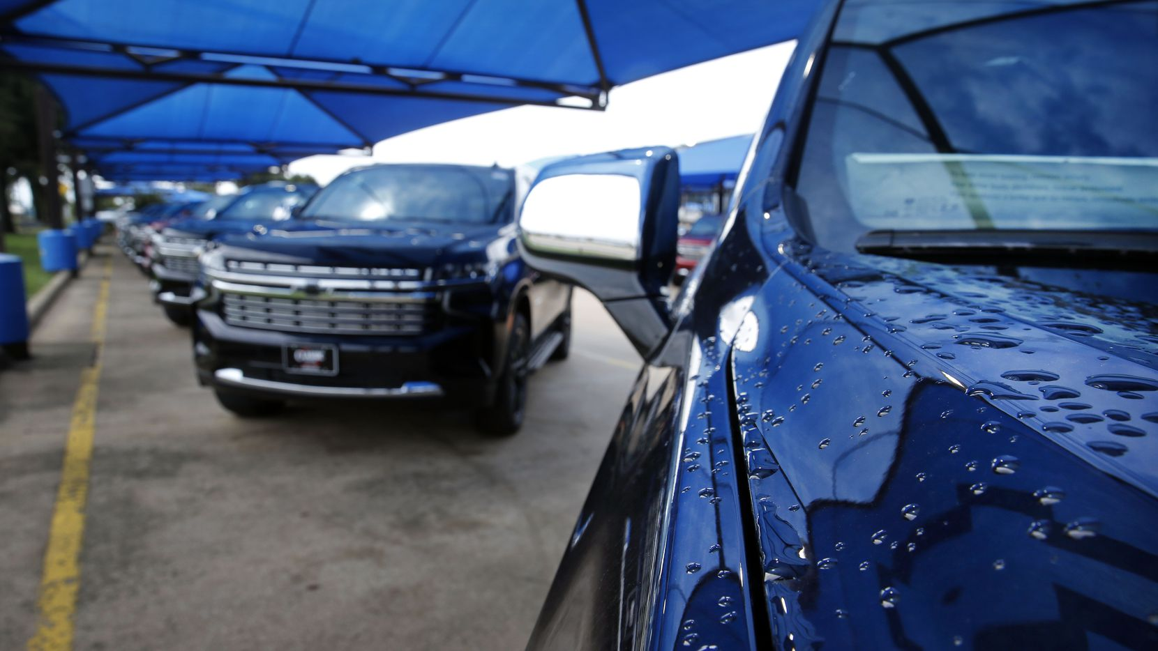 Rains drops cover the hood of a General Motors' Chevrolet Tahoe sport utility vehicle at Classic Chevrolet in Grapevine, Wednesday, September 2, 2020. (Tom Fox/The Dallas Morning News)