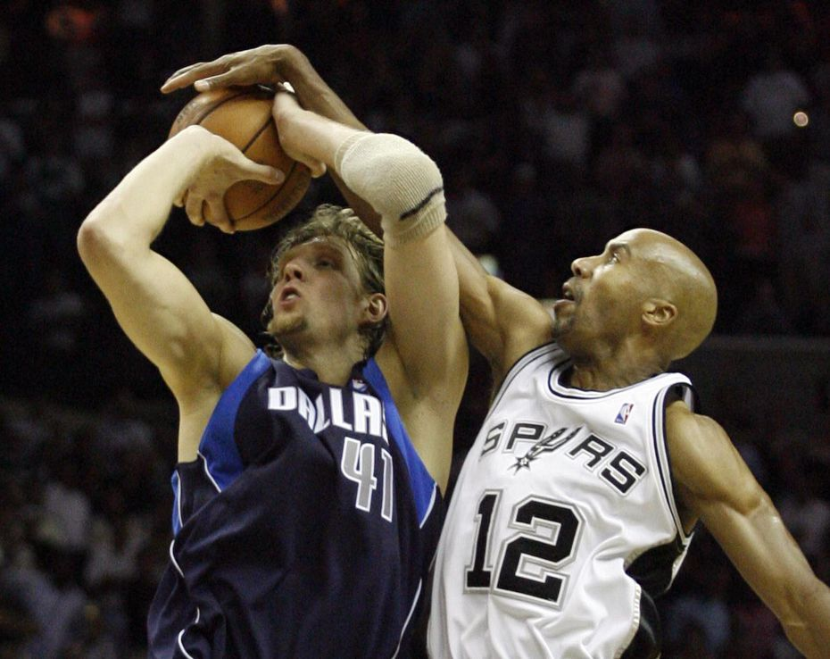 Dallas Mavericks Dirk Nowitzki is blocked by San Antonio Spurs Bruce Bowen during the second half of Game 5 of the Western Conference Semifinals between the Dallas Mavericks and San Antonio Spurs at the AT&T Center in San Antonio, TX on Wednesday, May 17, 2006.