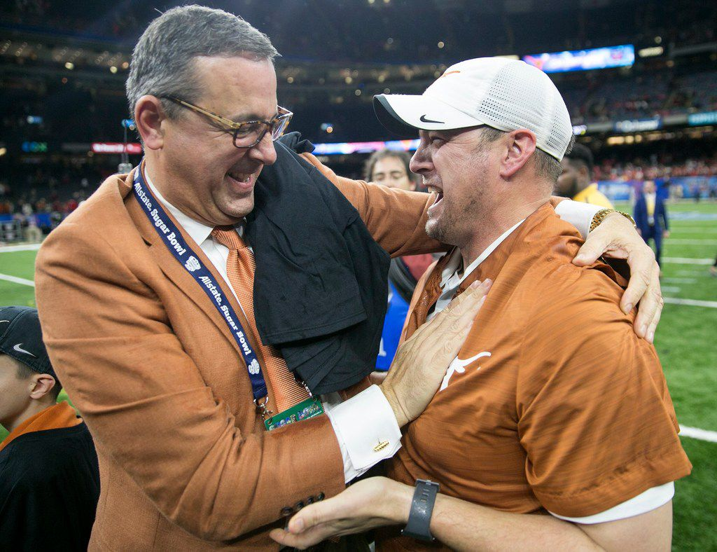 Texas athletic director Chris Del Conte congratulates Texas Head coach Tom Herman on the win over Georgia 28-21 during the Sugar Bowl NCAA college football game in New Orleans, LA.Tuesday, January 1, 2019.  [RICARDO B. BRAZZIELL/AMERICAN-STATESMAN]