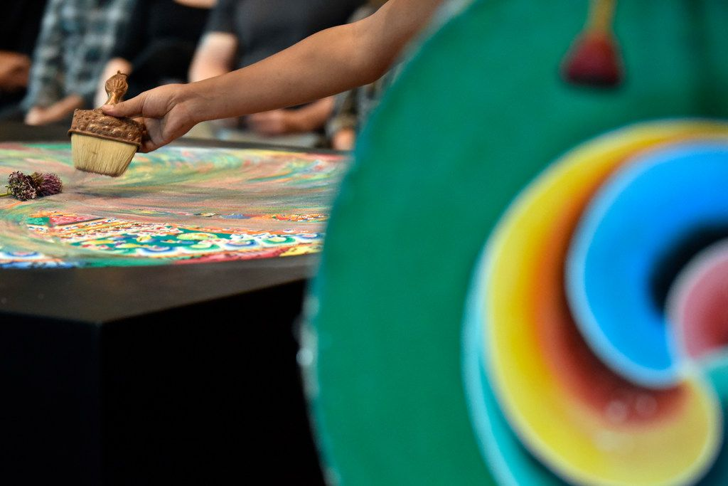 A Buddhist monk slowly destroys a mandala with a brush as fellow monks conduct a closing ceremony for the Mystical Arts of Tibet at the Crow Museum of Asian Art in downtown Dallas on Saturday, Oct. 13, 2018.