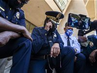 Chief U. Renee Hall (center) weeps as she and other officers kneel for 8 minutes and 46 seconds during the Blue for Black Lives demonstration led by Dallas Police in response to the murder of George Floyd at Dallas City Hall in Dallas on Friday, June 5, 2020. The demonstration took place on the eighth day of organized protests in response to the recent deaths of George Floyd in Minneapolis and Breonna Taylor in Louisville.