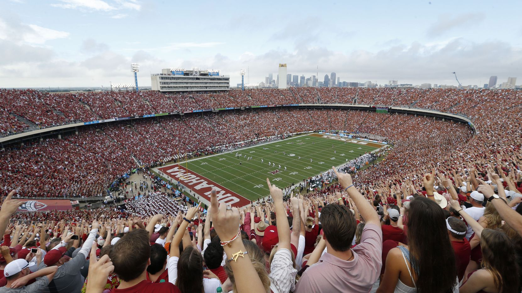 Oklahoma Sooners fans yell as Texas Longhorns kicks the ball off to Oklahoma at the start of a NCAA football game  between Texas Longhorns and the Oklahoma Sooners at the Cotton Bowl in Dallas on Saturday, October 6, 2018.