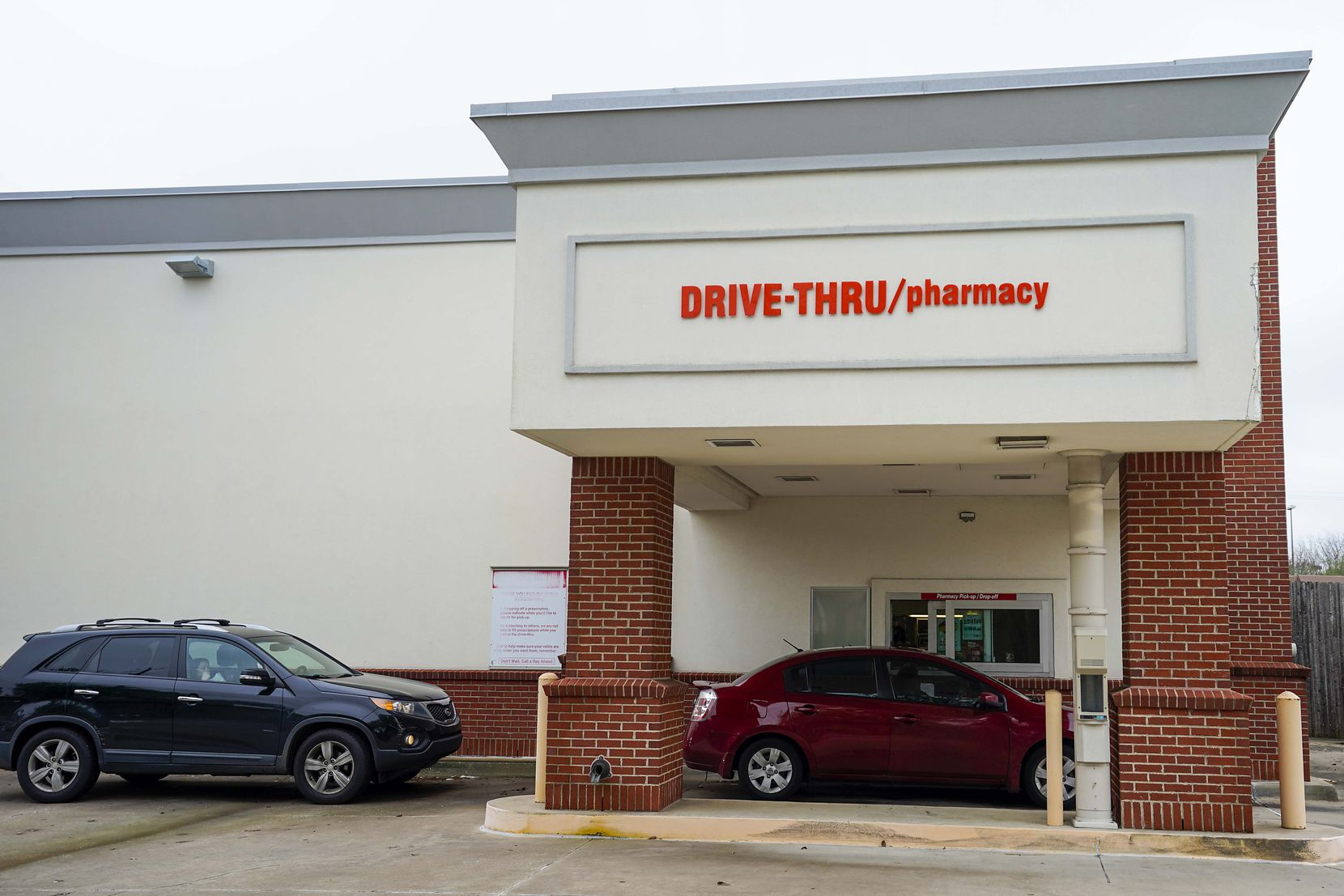 Cars line up for drive-thru service at a CVS pharmacy on Belt Line Road in Dallas on March 16. CVS is among numerous places in the Dallas area offering coronavirus testing, provided certain criteria are met.