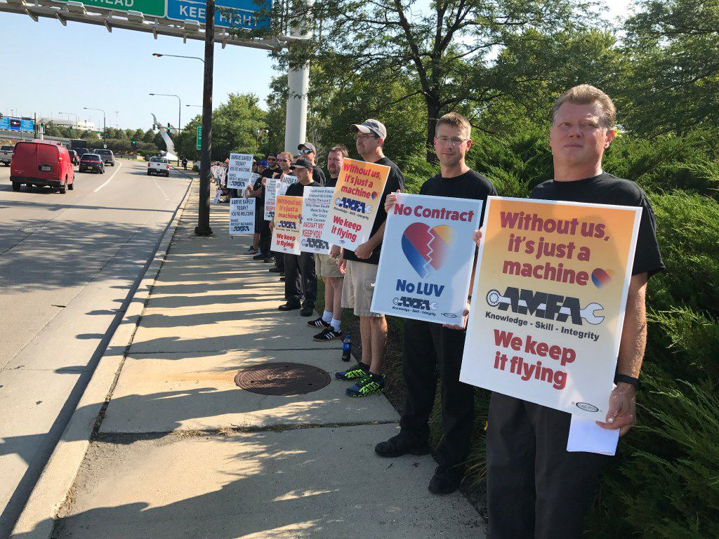 Hundreds of Southwest Airlines mechanics picketed at Chicago's Midway Airport in 2017. More recently, the airline said about 100 mechanics were flagging minor violations to sideline aircraft and pressure management for a new contract.