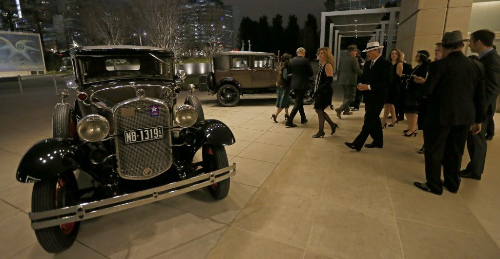 Guests look at antique cars including a 1931 Ford Deluxe Modal A Fodor Town Sedan (left) during the DMA Speakeasy event in celebration of Shaken Stirred Styled: The Art of the Cocktail at Dallas Museum of Art in Dallas, Saturday, Feb. 4, 2017.