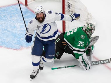 Goaltender Anton Khudobin (35) of the Dallas Stars and Pat Maroon (14) of the Tampa Bay Lightning react to a goal by Tampa's Blake Coleman (20) during Game Six of the Stanley Cup Final at Rogers Place in Edmonton, Alberta, Canada on Monday, September 28, 2020.