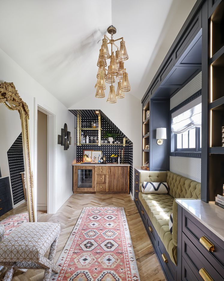 Burkle Creative designed the shared closet in the primary suite at the 2021 Kips Bay Decorator Show House Dallas. The space has separate storage areas for him and for her, with a dressing area complete with a bar and seating.
