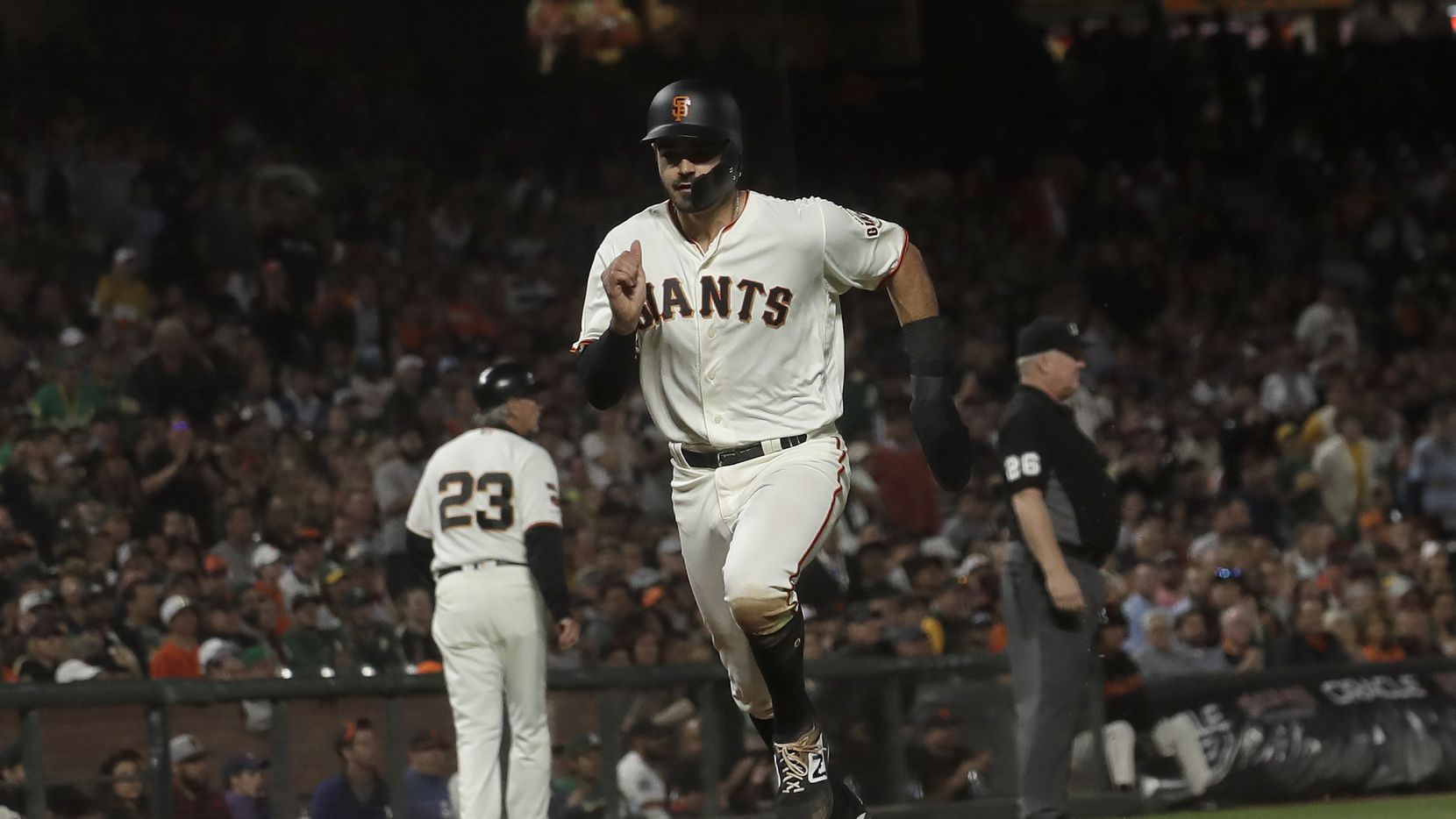 San Francisco Giants' Aramis Garcia scores against the Oakland Athletics during the seventh inning of a baseball game in San Francisco, Tuesday, Aug. 13, 2019.