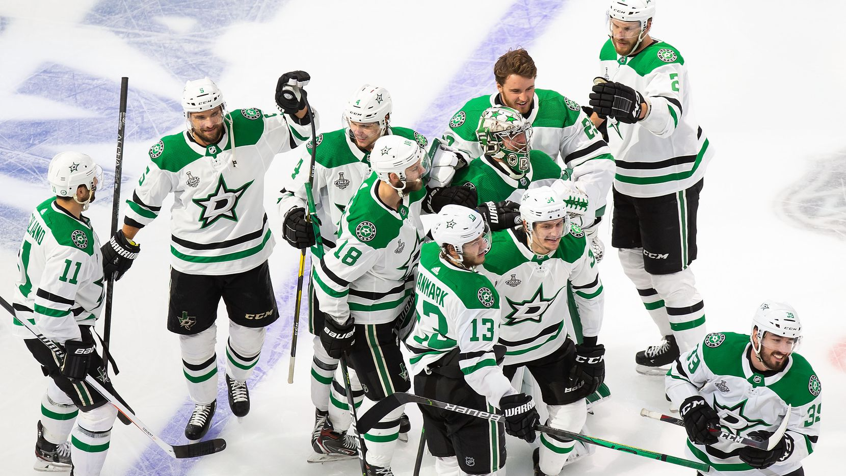 The Dallas Stars celebrate Corey Perry's game winning goal against the Tampa Bay Lightning during Game Five of the Stanley Cup Final at Rogers Place in Edmonton, Alberta, Canada on Saturday, September 26, 2020.