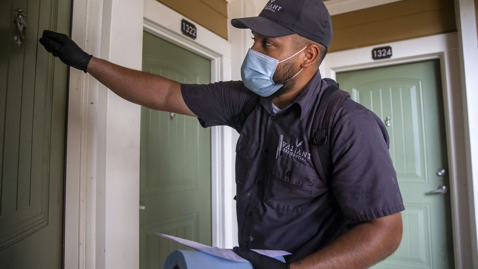 Valiant Residential assistant maintenance technician Rafael Muñoz does some work at the Lakewood Flats Apartments complex in Dallas.